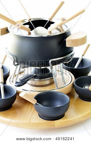 special set of utensils for cooking fondue (cheese, chocolate)