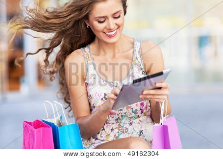 Shopping woman using digital tablet