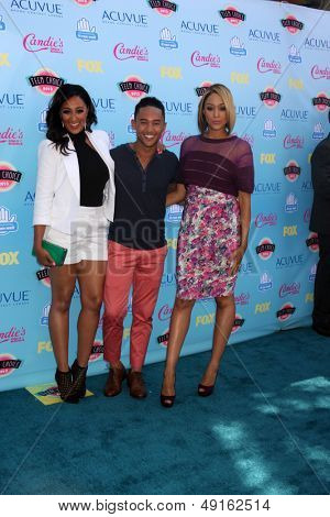 LOS ANGELES - AUG 11:  Tamara Mowry, Tahj Mowry, Tia Mowry at the 2013 Teen Choice Awards at the Gibson Ampitheater Universal on August 11, 2013 in Los Angeles, CA