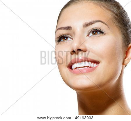 Healthy Smile. Teeth Whitening. Beautiful Smiling Young Woman Portrait. Over White background . Laughing Girl
