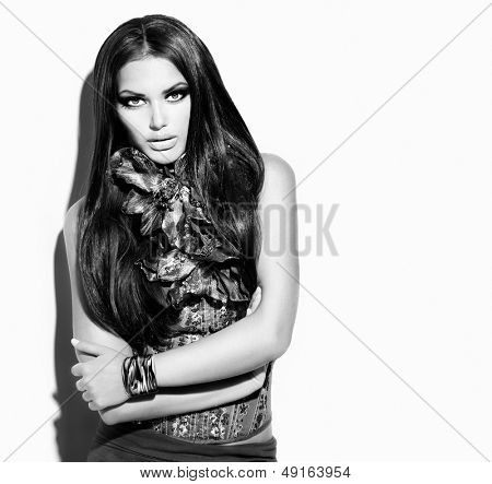 Beauty Fashion Model Girl Black and White  Portrait. Vogue Style Woman. Ling Healthy Hair and Beautiful Makeup. Trendy Wear