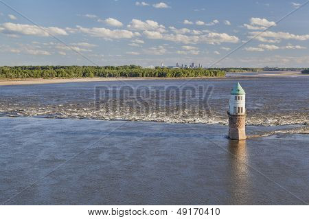 Mississippi RIver at Chain of Rocks with historical water intake tower and distant cityscape of St Louis