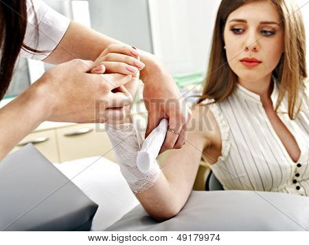 Bandaging hand patient in hospital. Sharpness of hand.