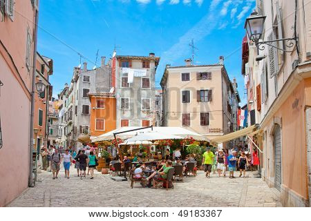 ROVINJ, CROATIA - JULY 3: People walk the old town streets on July 3, 2013 in Rovinj, Croatia.Total 6.6 million tourists holidayed in Croatia from January to July 2013.