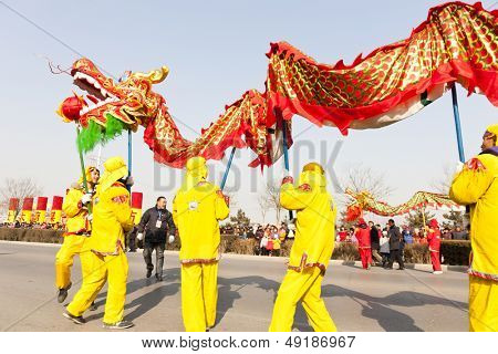 YU COUNTY CHINA FEBRUARY 5: People performing traditional dragon dance for celebrating Lantern Festival on February 5 2012 in Yu County, China.
