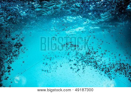 Many bubbles in water close up, abstract water wave with bubbles