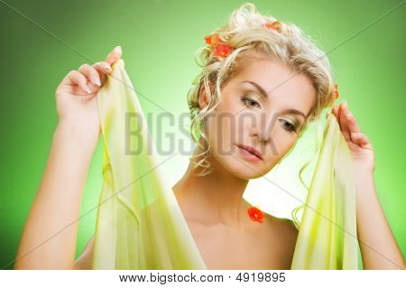 Portrait Of A Sad Beautiful Woman With Flowers In Her Hair. Spring Concept