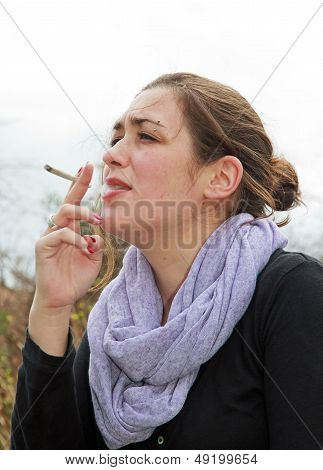 woman smoking cigarette at the outdoor