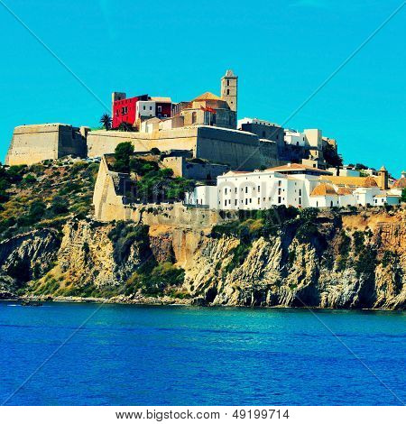 view of Sa Penya district and Dalt Vila district, the old town of Ibiza Town, in Balearic Islands, Spain, with a retro effect
