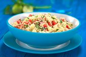 foto of tabouleh  - Fresh homemade Tabbouleh an Arabian vegetarian salad made of couscous tomato cucumber onion garlic parsley and lemon juice served in a blue bowl (Selective Focus Focus one third into the tabbouleh) ** Note: Shallow depth of field - JPG