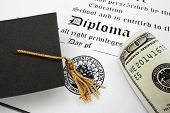 stock photo of tassels  - graduation cap and money on a diploma - JPG