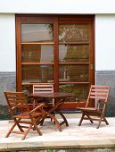 foto of wooden table  - Set of table in the back yard of villa - JPG