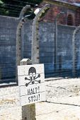 image of auschwitz  - Sign Stop  in a camp in Auschwitz - JPG