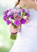 image of wedding bouquet in bride's hand