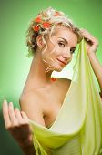 Beautiful Young Woman With Fresh Flowers In Her Hair. Spring Concept.
