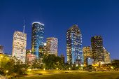 stock photo of highrises  - View on downtown Houston by night with skyscraper - JPG