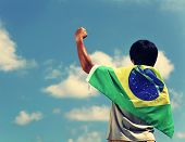 image of nylons  - Excited man holding a brazil flag - JPG