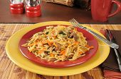 image of lo mein  - Beef chow mein on colorful plates with a cup of tea - JPG