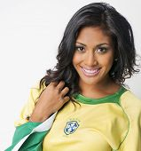 stock photo of thong  - Beautiful Brazilian young woman with happy smiling woman wearing Brazil football top - JPG