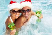 foto of hot couple  - Happy christmas santa couple in hot tub - JPG