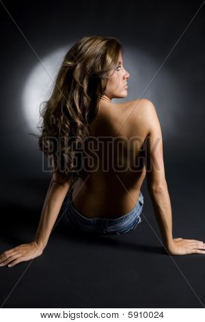 Dramatic Studio Shot Of Topless Brunette In Jean Shorts