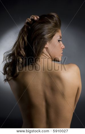 Topless Brunette Woman Holding Up Her Hair