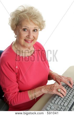 Beautiful Senior At Computer