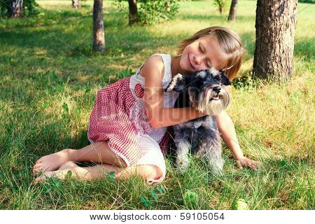 Cute Girl Hugging Her Dog