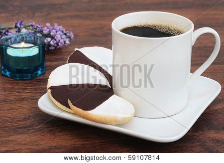 Black And White Cookies With A Cup Of Coffee