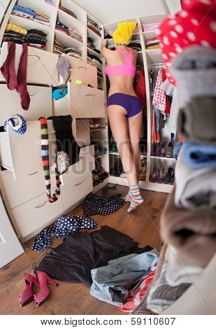 Getting dressed concept, woman after shower in walk in closet