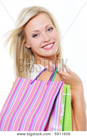 Portrait Of Smiling Blonde Woman With Shopping Bags