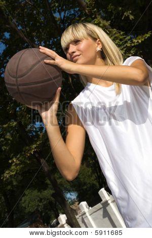 Girl Playing Basketball Outside