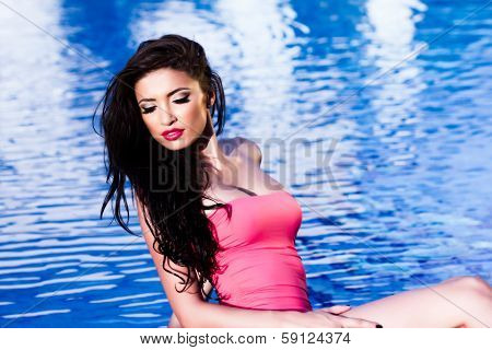 Beautiful Woman At The Pool