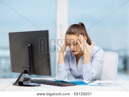 business, office, school and education concept - stressed businesswoman with computer and documents at work
