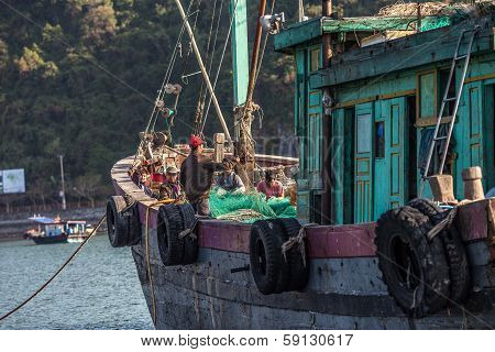 Vietnamese fishermen in Halong Bay