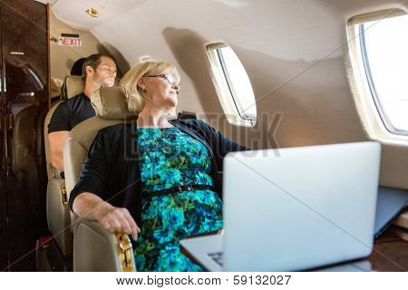 Business people sleeping on private plane