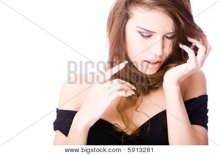 passionate young woman touching her long hair twisted over her neck