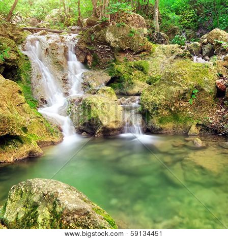 Waterfall. Mountain River. Spring Wood And River.