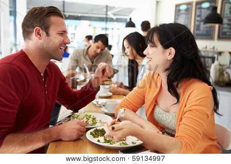 Couple Meeting For Lunch In Busy Caf���©