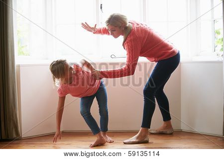 Mother Hitting Young Daughter