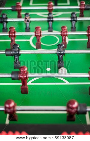 Close up of a foosball game with soccer ball