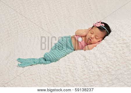 Sleeping Newborn Baby Girl In A Mermaid Costume