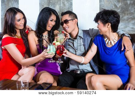 Asian young and handsome party people man flirting with women in fancy night club