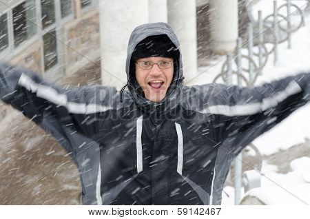 Man Jumping And Enjoying The Winter