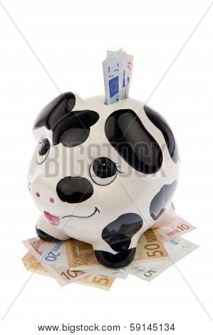 Pig In Bed Of Banknotes And In Slot Left