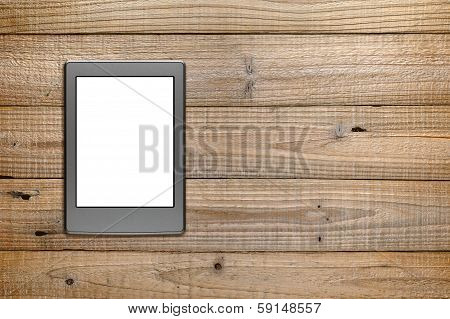 E-reader On Wooden Background