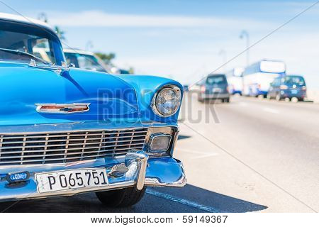 HAVANA,CUBA - JANUARY 20, 2014:Classic Chevrolet parked at the famous Malecon Avenue.Tens of thousands of these cars are still in use in Cuba and have become a well known icon of the country