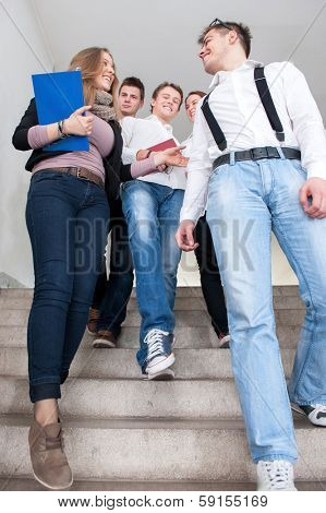 Students descending steps in school talking