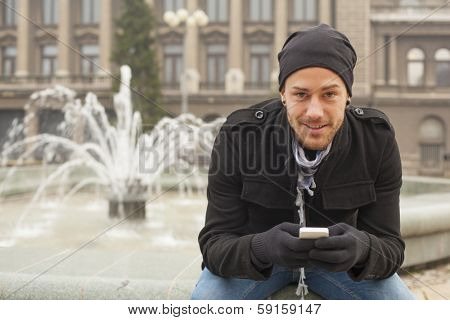 Young Man With Mobile Phone Outdoor