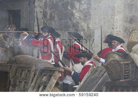 Assault city of Brihuega, during the re-enactment of the War of Succession. September 4, 2010 in Brihuega, Spain